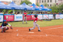Batter missed the ball in a baseball game. ZHONGSHAN PANDA CUP, ZHONGSHAN, GUANGDONG - July 23:batter of team WuXi Experimental Primary School missed the ball Stock Photos
