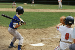 Batter preparing to hit baseball Stock Images