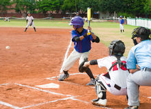 Batter about to hit the ball Royalty Free Stock Photo