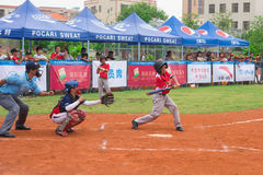 Batter about to hit the ball in a baseball game. ZHONGSHAN PANDA CUP, ZHONGSHAN, GUANGDONG - July 23:batter of team WuXi Experimental Primary School about to hit Stock Photos