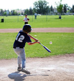 Batter Up. A young boy ready to hit the ball on a baseball team Royalty Free Stock Image
