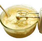 Batter Up 2. Cake batter in bowl with mixer and wooden spoon. Isolated image with clipping path royalty free stock photos