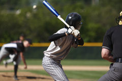 Batter up. A batter about to hit a pitch during a baseball game Royalty Free Stock Photo