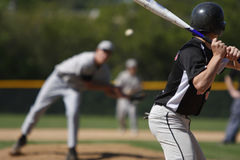 Batter up. A batter about to hit a pitch during a baseball game Royalty Free Stock Photos