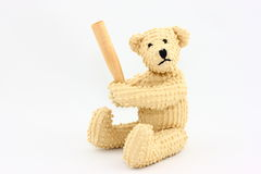 Batter Up Bear. A cute teddy bear poses with his baseball bat on a white background Stock Images