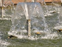 Batter up jets of fountain with clean water Royalty Free Stock Photography