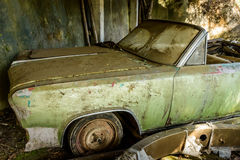 Battered, abandoned, old car Royalty Free Stock Photography