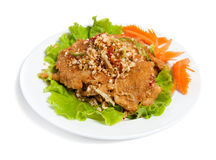 Battered beef with peanut on a plate Stock Photography