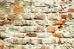 Battered brick wall. Exterior side Stock Images