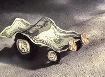 Battered car model made of USD currency Royalty Free Stock Photography