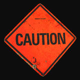 Battered Caution Sign Stock Image