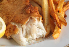 Battered fish with chips Stock Photo