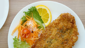 Battered fish steak with salad and vegetable stock photo