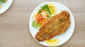 Battered fish steak with salad and vegetable Stock Photography