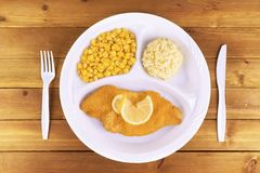 Battered fish tv dinner on wooden background. Top view Stock Photos