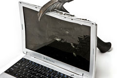 Battered Laptop with Hammer royalty free stock photos