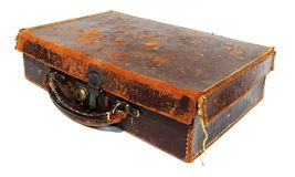 Battered old brown leather suitcase. Against a white background stock photography