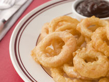 Battered Onion Rings worth Barbeque Sauce Royalty Free Stock Photos
