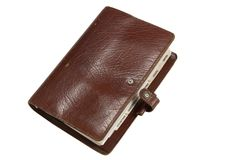 Battered personal organiser. Brown leather old personal organiser isolated on white with path Stock Image