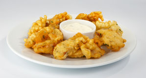 Battered pike perch. Battered pike perch with white sauce Stock Photography