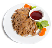 Battered pork with sauce on a plate Royalty Free Stock Images