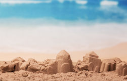 Battered sandcastles on background of ocean Royalty Free Stock Photography