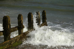 Battered sea defences. Wooden sea defence groyne worn away by the sea Royalty Free Stock Photography