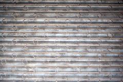 Battered Security Bars and Rusted Metal Shutters Stock Photo