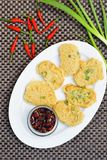 Battered sliced tempeh with chili soy sauce. Tempe Mendoan, Indonesian food, battered sliced fried Tempeh served with chili soy sauce Royalty Free Stock Photos