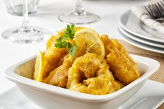 Battered squid. Rings served with lemon royalty free stock images