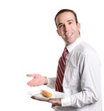 Battered Wiener. A young server is displaying a battered wiener on a plate, isolated against a white background Stock Image