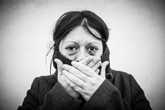 Battered woman with eyes damaged Stock Photo