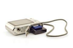 Batteria e scheda di memoria in una macchina fotografica compatta Immagine Stock Libera da Diritti