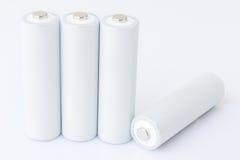 Batterie AA sopra bianco Immagine Stock Libera da Diritti