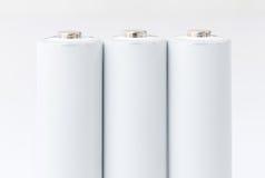 Batterie AA sopra bianco Immagini Stock