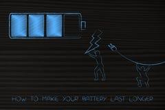 Batterie mit Männern Haltebolzen und Stecker in Richtung zu ihr Stockbilder