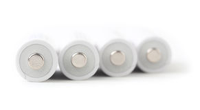Batterie ricaricabili di aa su fondo bianco Immagine Stock Libera da Diritti