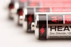 Batterien auf Weiß Stockfotos