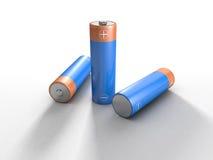 Batterien, die auf Weiß liegen lizenzfreie stockbilder