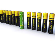 Batteries. Lined up on a white background with a green battery in the middle (3d render Stock Image