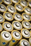 Batteries. A frameful of yellow batteries Royalty Free Stock Images