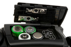Batteries. Four batteries in a slot Royalty Free Stock Images