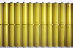 Batteries. Set of AA batteries lined up on a white  background Stock Images