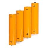 Batteries. Orange batteries on white background Royalty Free Stock Photo