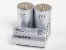 Batteries. Three batteries on white background Stock Photography