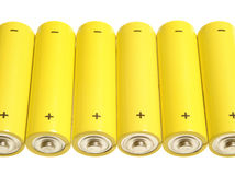 Batteries. Yellow batteries over white Stock Photography