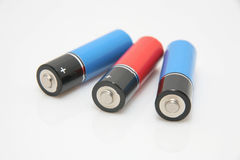 Batteries. Three cylindrical batteries on a white background Royalty Free Stock Images