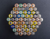 Batteries. Battery AA texture blurred in a row. Rows of batteries, top view. Multicolored batteries AA, cell row hexagon organized Stock Images