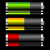 Batteries with charge levels. Batteries with different charge levels and reflex over black Stock Photography