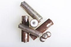 Batteries of corrosion of various shapes and sizes. Lies loose on a white background. Environmental protection, recycling of used. Batteries stock image